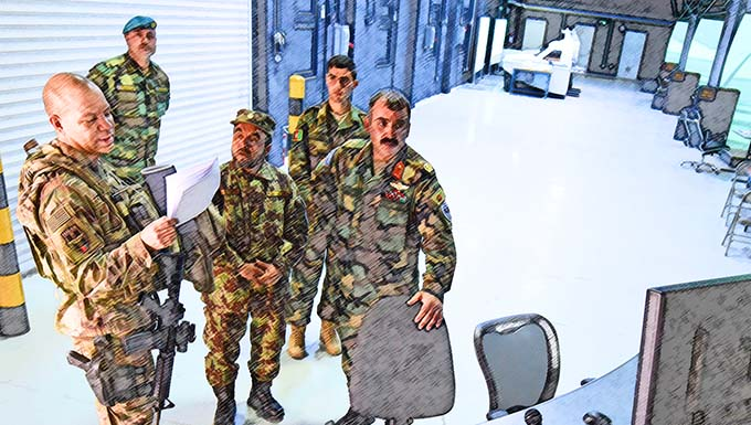 Lt. Col. Jose Lasso, Train, Advise, Assist Command-Air (TAAC-Air) deputy director of logistics, receives a tour of a flight simulator training facility from Afghan Air Force Brig. Gen. Abdul Qudratullah, Shindand Air Wing commander, at Herat, Afghanistan, March 1, 2017. This visit was an opportunity for advisors to have face-to-face interaction with their AAF counterparts. TAAC-Air headquarters is based out of Kabul, Afghanistan.