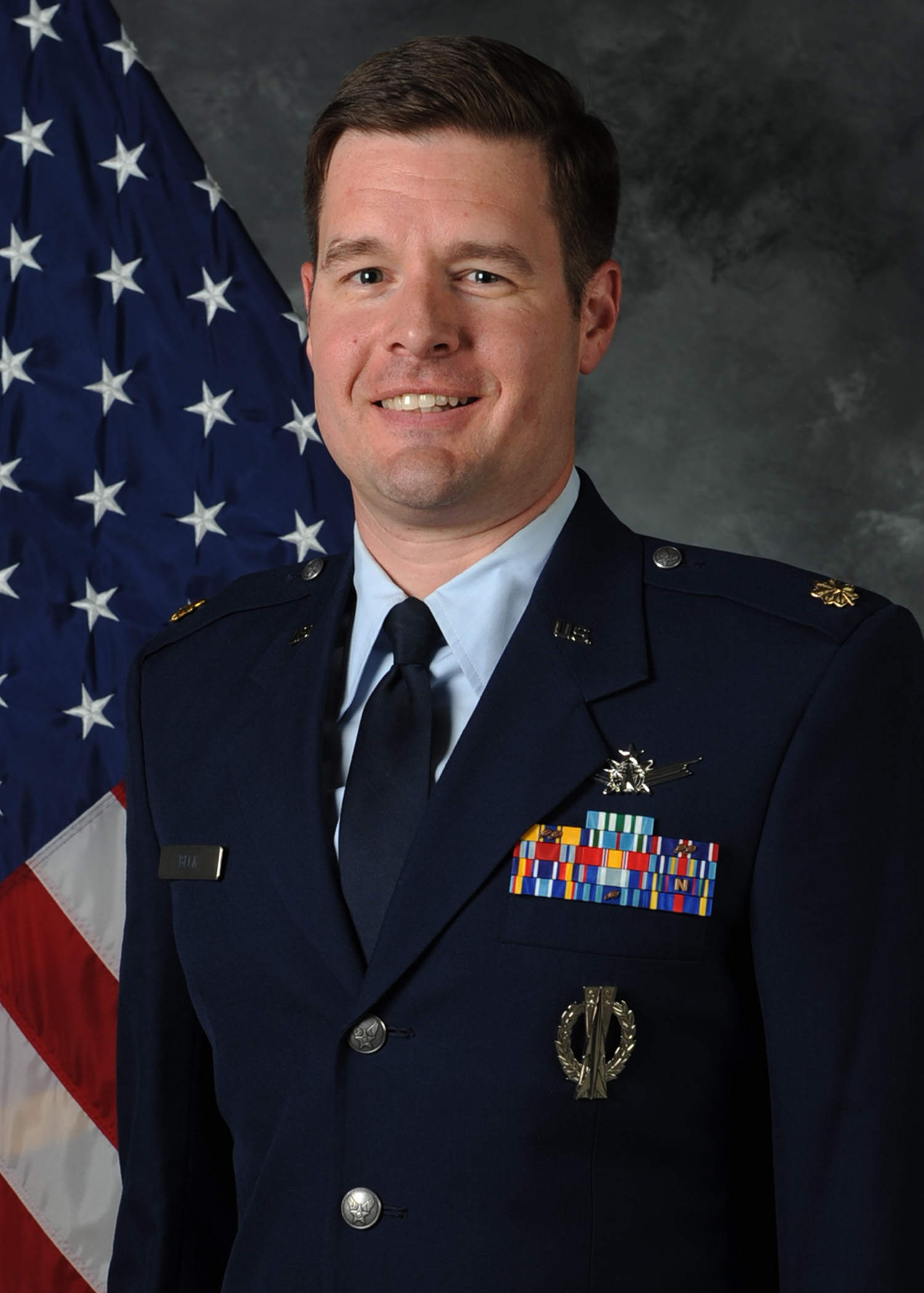 Photo of Maj Mathew Beck, USAF wearing military uniform