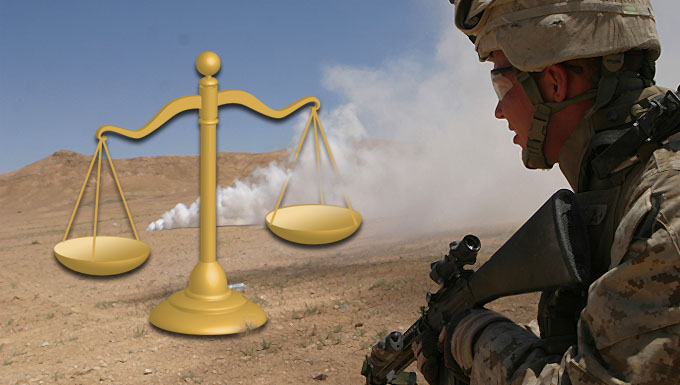 Profile of US soldier with weapon in desert. A smoke bomb is going off in the background and an image of scales appears on the lefthand side.