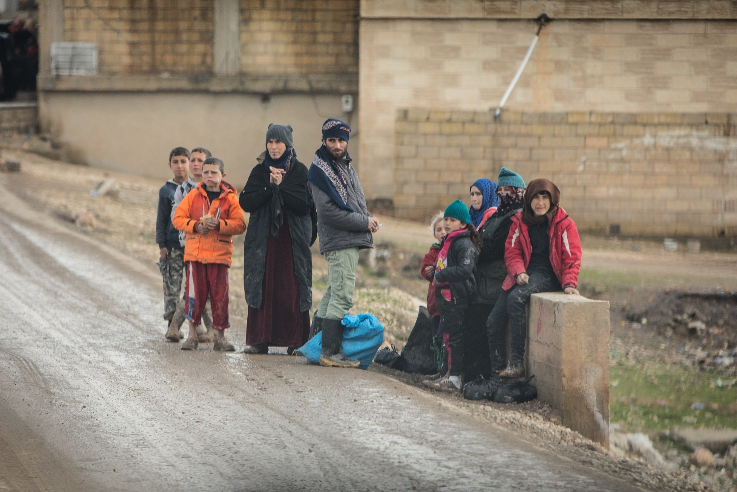 Syrian children waiting for school bus