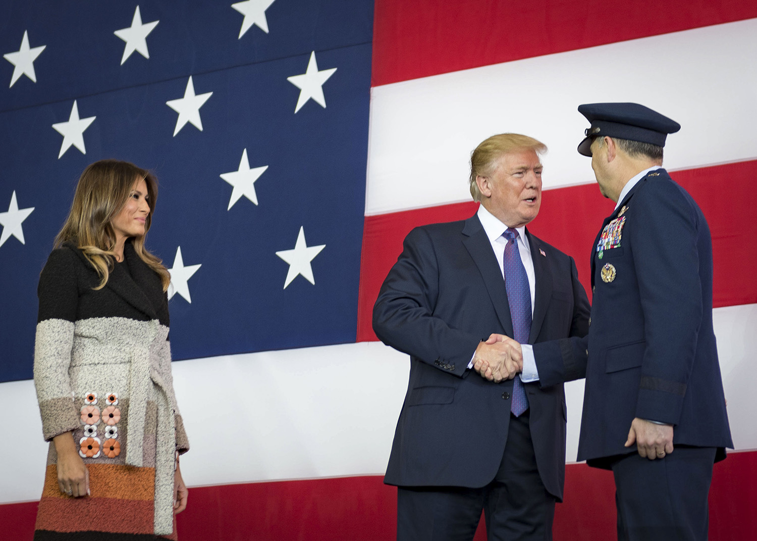 Trump visits Yokota Air Base, Japan. Pres. Donald J. Trump greets Lt Gen Jerry P. Martinez, US Forces Japan and 5th Air Force commander, during a Troop Talk, 5 November 2017, at Yokota Air Base, Japan. During his talk, Trump highlighted the importance of the US–Japan alliance in the Indo-Pacific.